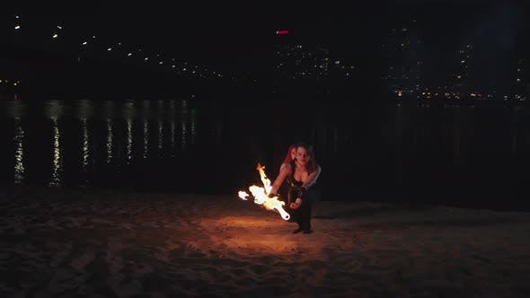 Thumbnail for Firegirls Doing Movements Holding Burning Torches