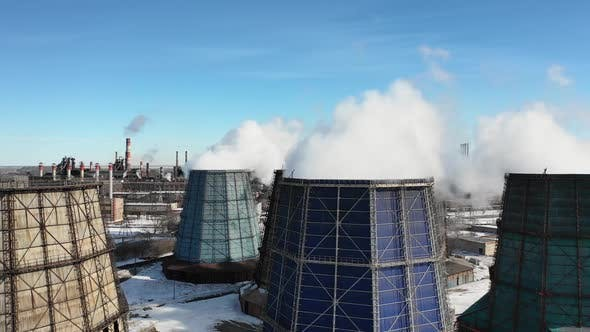 Cover Image for Flying Over the Plant Producing Thermal Energy with Large Pipes. Aerial Shot. Ecology Problem
