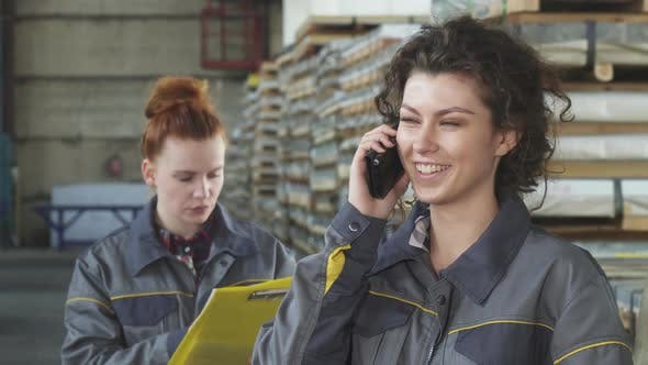 Thumbnail for Beautiful Happy Female Factory Worker Talking on the Phone