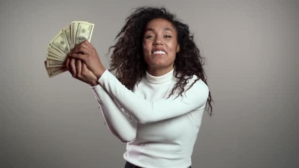 Thumbnail for Satisfied Happy Excited African Woman Showing Money - U.S. Currency Dollars