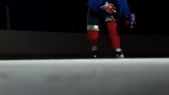 Thumbnail for Close-up Slow Motion Hockey Puck and Flying Snow, Hockey Player Picks Up the Puck Stick