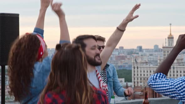 Thumbnail for Clubbers Waving Their Arms at Day Rooftop Party