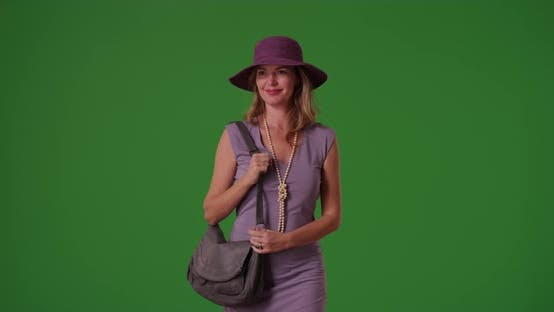Thumbnail for Woman in fancy clothes walking toward the camera looking on green screen