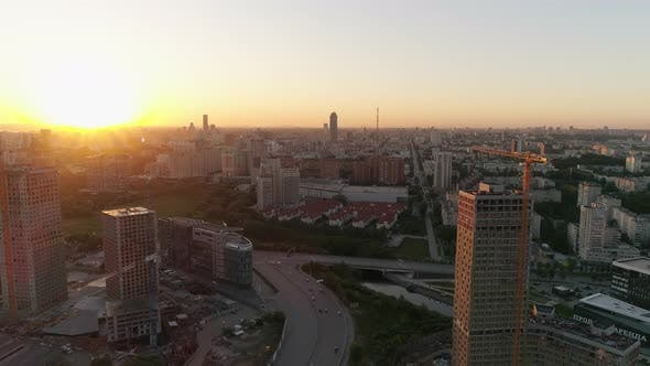 Aerial drone view of city at sunset 38