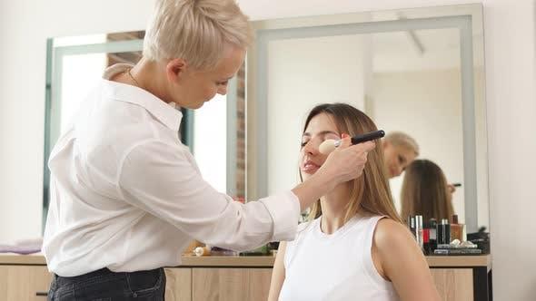 Famous Talented Make-up Artist Doing Make-up on Model.