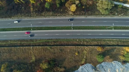 Aerial Drone Footage. Fly Over Autobahn Near Forest Top View Shot