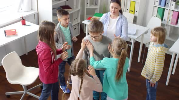 Thumbnail for Teenager Playing Trust Building Game with Other Kids and Psychologist