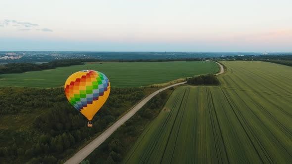 Hot Air Balloon in the Sky Over a Field