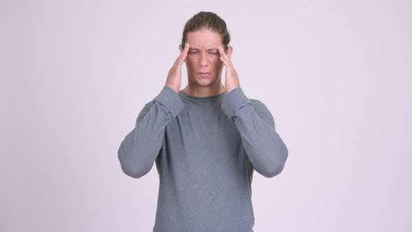 Thumbnail for Stressed Man Having Headache Against White Background