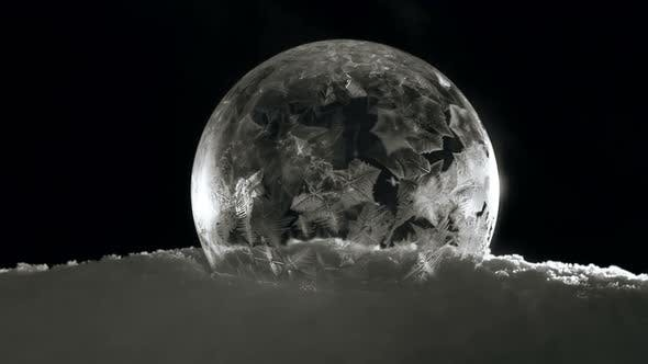 Thumbnail for Frozen Ice Globe with Snow Flakes