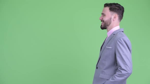 Thumbnail for Profile View of Happy Young Bearded Businessman Smiling