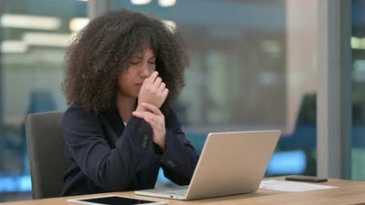 African Businesswoman with Laptop Having Wrist Pain