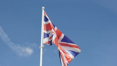 Slow motion England and United Kingdom flag  flowing against blue sky  1920X1080 HD footage - Slow-m