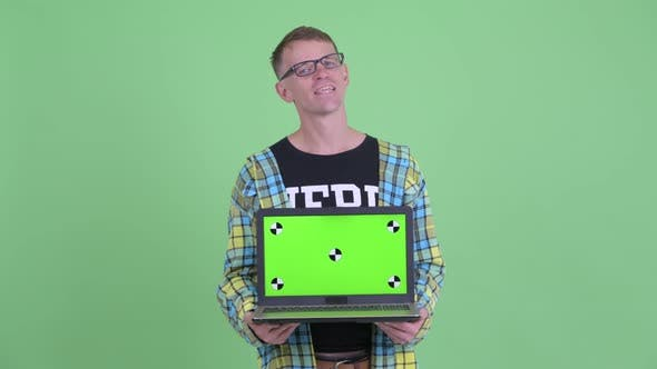 Thumbnail for Portrait of Happy Nerd Man Thinking While Showing Laptop