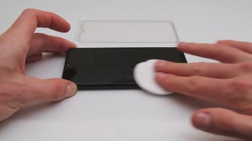 Preparing to Replace the Protective Glass on a Smartphone Degreasing Screen