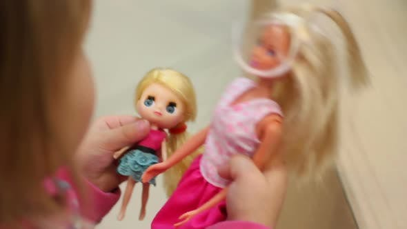 Thumbnail for Little Girl Playing Nice Role Game With Mother and Baby Dolls, Happy Childhood