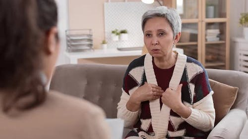 Woman Sharing Emotional Pain with Therapist