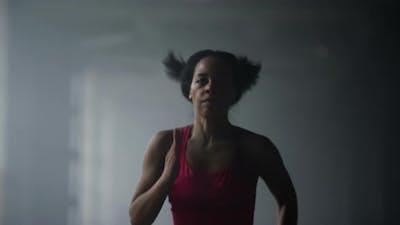 Sporty Girl Jogging in Gym