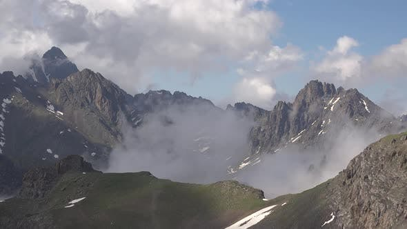 Cover Image for Clouds Passing Around the Sharp Peaks in High Altitude Mountain Climate