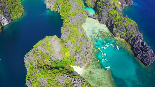 Thumbnail for Fly Around Tourist Boats Near the Mountains with Beautiful Big and Small Lagoons in El Nido, Palawan