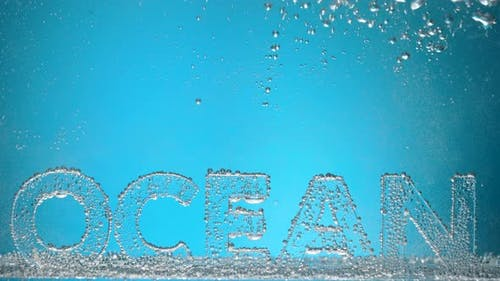 Word Ocean Underwater in Oxygen Bubbles on Blue Background