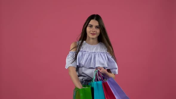 Thumbnail for Girl Gets a Shoe From the Bag and She Is Happy Wind Spinning, Pink Background, Slow Motion