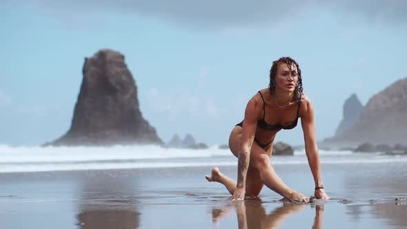 Thumbnail for The Girl Is Engaged in Stretching and Gymnastics on the Shore of the Ocean