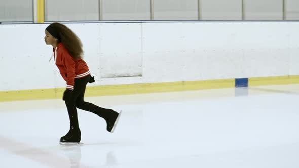 Thumbnail for African Girl Skating on Ice Arena