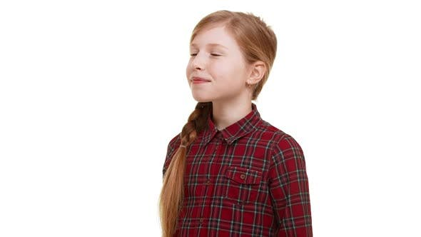 Cute Lovely Caucasian Elementaryschool Aged Girl Clamly Standing on White Background with Little