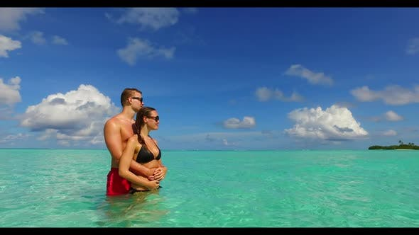 Thumbnail for Teenage lovers sunbathe on tropical coast beach adventure by aqua blue lagoon with white sandy backg