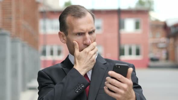 Thumbnail for Businessman in Shock while Using Smartphone