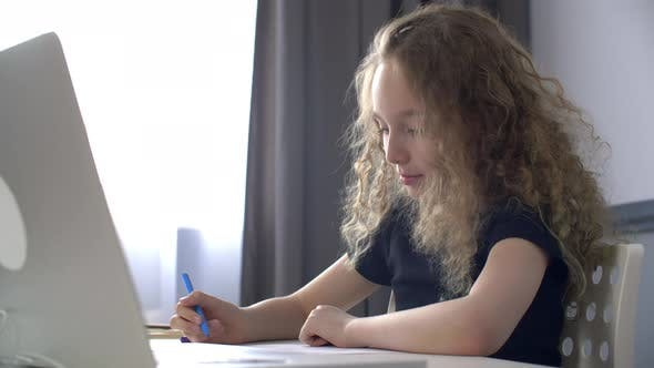 Smiling Young Girl Drawing with Felt-tip Pens