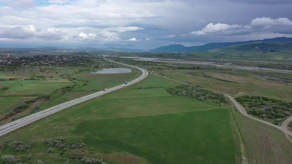 Freeway among green fields