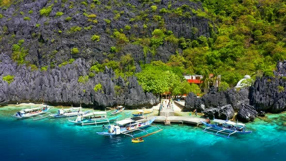 Thumbnail for Beautiful Coral Reef, Boats and a Clear Ocean on Matinloc Island, Bacuit Archipelago
