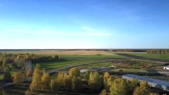 Thumbnail for Bird Eye View Livestock Complex Among Fields and Forests