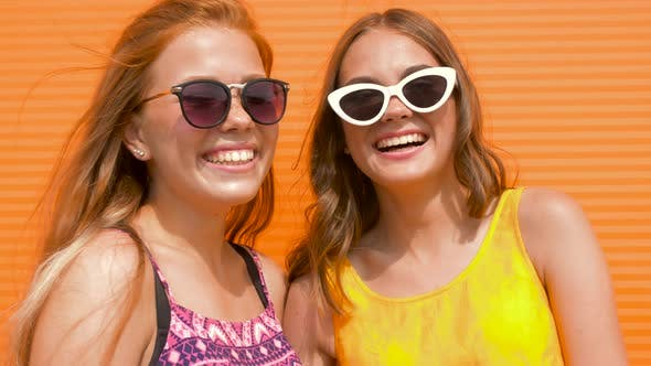 Thumbnail for Smiling Teenage Girls in Sunglasses Outdoors