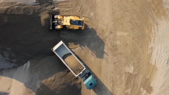 Thumbnail for Overhead View of Bulldozer in Open Air Quarry