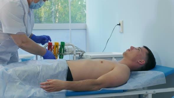 Thumbnail for Nurse Preparing Male Patient for ECG Test