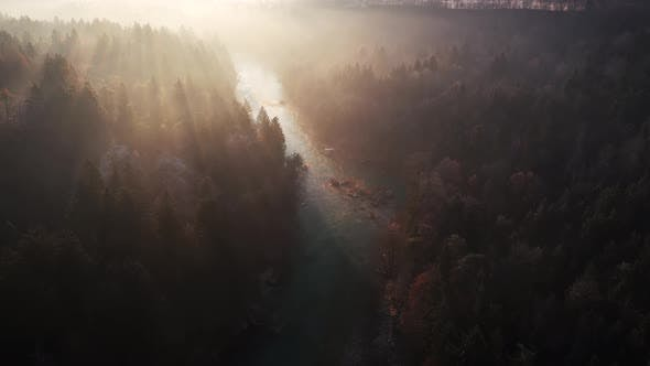 Flying over the river and hills at sunrise