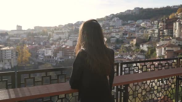 Thumbnail for Brunette Girl Enjoying Panoramic View Over Veliko Tarnovo City at Susnet