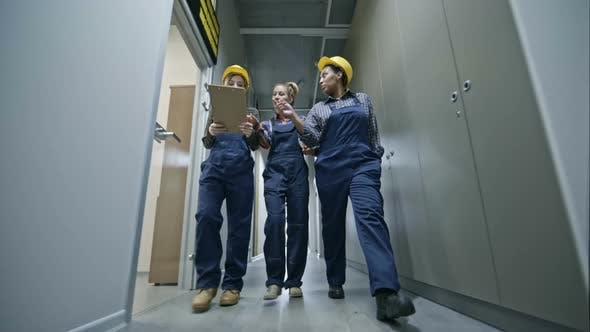 Cover Image for Construction Workers Going through Corridor