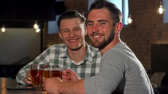Thumbnail for Cheerful Men Smiling To the Camera, While Having Beers at the Bar