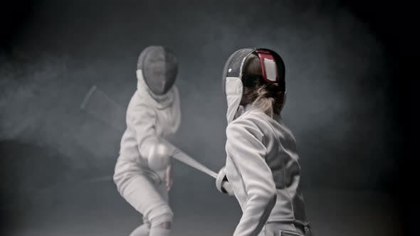Thumbnail for Fencing Training - Two Young Woman Having a Duel Between Each Other