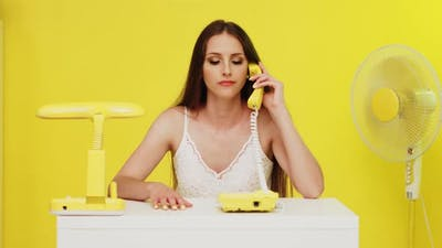 Young Woman Has Problems With Landline Phone Connection