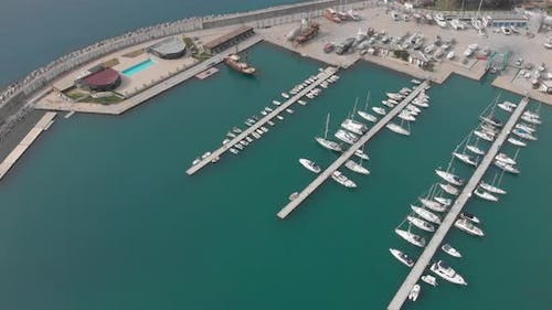Docked recreational boats and yachts in marina, aerial view