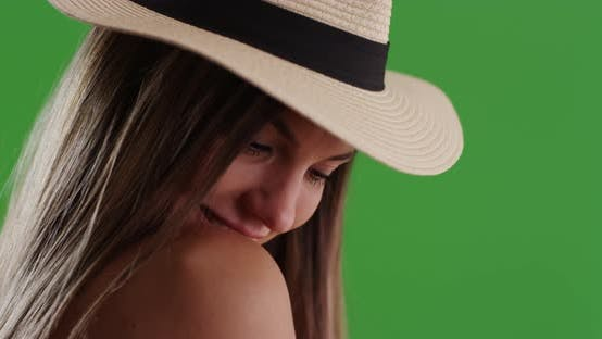 Thumbnail for Close up of millennial woman in fedora looking over her shoulder on greenscreen