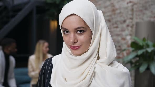 Thumbnail for Attractive Muslim Woman in White Hijab Headscarf Looking at Camera