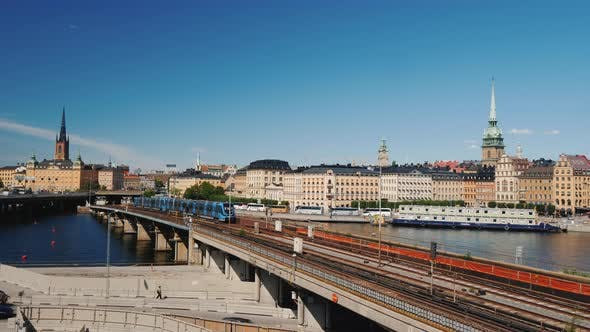 Thumbnail for Subway Train Travels Across the Bridge Against the Backdrop of the Stockholm City Line, Sweden