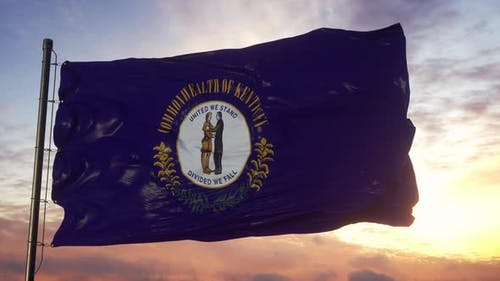 Flag of Kentucky Waving in the Wind Against Deep Beautiful Sky at Sunset