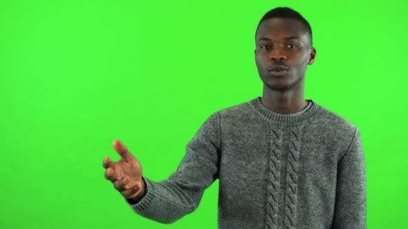 Thumbnail for A Young Black Man Talks To the Camera - Green Screen Studio